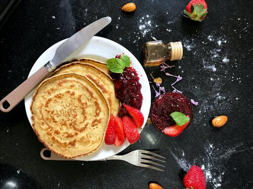 Some delicious looking pancakes and a huge kitchen mess.